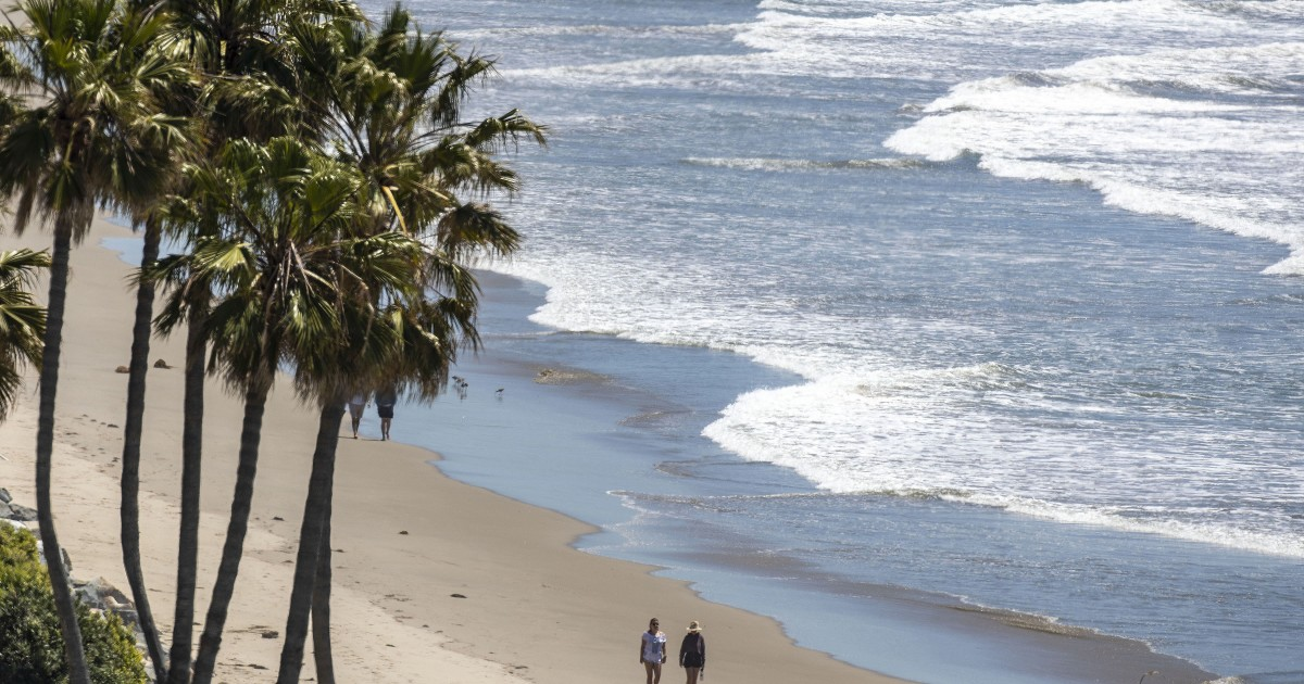 Photos: As heat wave hits, L.A. County beaches still closed